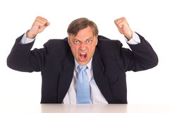 Angry office worker. Portrait of a businessman posing on white Stock Photo