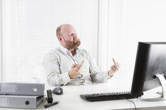 Angry Businessman Gives Finger to his Computer Royalty Free Stock Photo