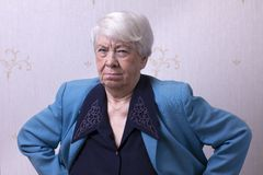 Angry old woman. At home Stock Image