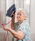 Angry old woman with an iron Royalty Free Stock Images