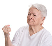 Angry old woman making fist Stock Image