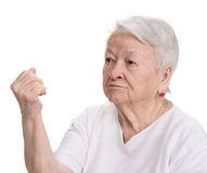 Angry old woman making fist Stock Photo