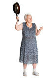 Angry old woman with a pan Stock Images