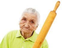 Angry Old Woman Threatening With A Rolling Pin Royalty Free Stock Image
