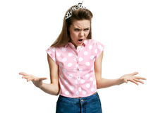 Angry open-mouthed girl spread her hands Royalty Free Stock Photography
