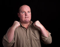 Angry overweight male on black background Royalty Free Stock Photo