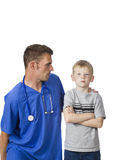 Angry patient. A doctor tries to speak to an angry young child Stock Image