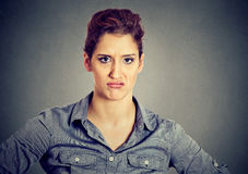 Angry pessimistic woman with bad attitude looking at you Stock Images