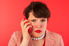 Angry phone call on the smartphone Royalty Free Stock Images