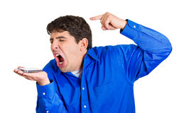 Angry on phone Stock Images