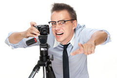 Angry Photographer With Camera On White Royalty Free Stock Photos
