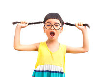 Angry pigtail. Asian little girl pull her pigtail with angry emotion Stock Image