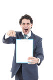 Angry pissed off man holding up a banner or notes against a whi. Angry pissed off man in suit holding up a banner or notes against a white background and showing Stock Photo