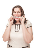 Angry plus size woman gnawing centimeter. On white background Stock Images
