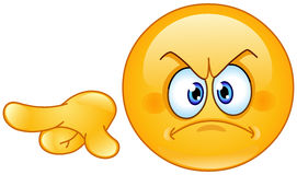 Angry pointing out emoticon Stock Photo