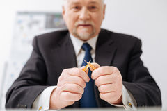 Angry powerful businessman breaking pencil in the office Royalty Free Stock Photos