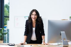 angry pregnant businesswoman screaming while looking at camera stock images