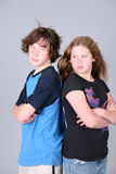 Angry preteens. Two angry preteens back to back Stock Photos