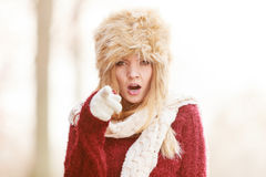 Angry pretty fashion woman in fur winter hat Royalty Free Stock Photo