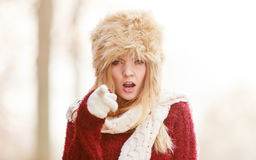 Angry pretty fashion woman in fur winter hat Royalty Free Stock Images