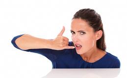 Angry pretty female gesturing a call Stock Images