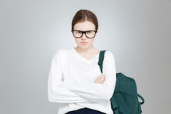 Angry pretty girl student in glasses with backpack Royalty Free Stock Photography