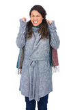 Angry pretty model with winter clothes posing Royalty Free Stock Photos