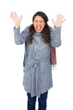 Angry pretty model with winter clothes screaming Stock Photos