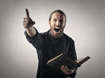 Angry priest Stock Photos
