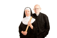 Angry priest and nun. Portrait of angry priest and nun in black Stock Photo