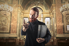 Angry priest. Warning someone in the church royalty free stock photo