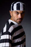 The angry prison inmate in dark room Stock Photography