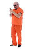 Angry prisoner. Prisoner making a very angry phone call Stock Photo