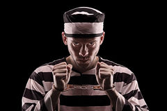 Angry prisoner with handcuffs Stock Photo