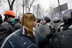 Angry protester in a military helmet arguing with  Royalty Free Stock Images