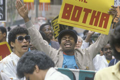 Angry protesters holding sign, Los Angeles, California Stock Photos