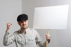 Angry protesting worker with blank protest sign.  stock photo