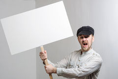 Angry protesting worker with blank protest sign Royalty Free Stock Images