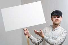 Angry protesting worker with blank protest sign.  royalty free stock photo