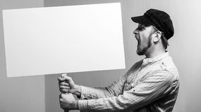 Angry protesting worker with blank protest sign.  stock photography