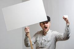 Angry protesting worker with blank protest sign.  stock photos