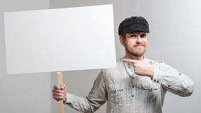 Angry protesting worker with blank protest sign Stock Photos