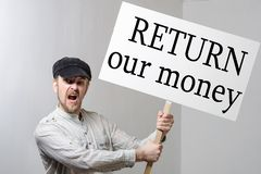 Angry protesting worker with protest sign inscription return our money.  stock photo