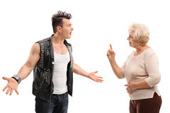Angry punk arguing with grandmother Royalty Free Stock Photos