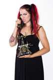 Angry Punk Girl with Antique Phone Stock Photography