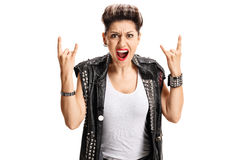 Angry punk girl making rock hand gesture Stock Image