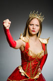 Angry queen against Royalty Free Stock Photo
