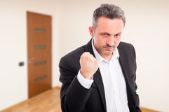 Angry realtor threaten with a fist rised up Royalty Free Stock Photos