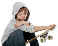 Angry rebellious girl sitting on skateboard Stock Photos