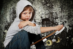 Angry rebellious girl with skateboard Stock Photos